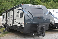 2019 Palomino Puma 31FKRK Travel Trailer Front Kitchen 2 Slides Residential Fridge 2 A/C's Fireplace W/D Prep Outside Kitchen w/Induction Cooktop Duncan SC