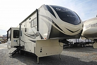 2019 Solitude Fifth Wheel S-Class ST3350RL-R Rear Living Fireplace Theatre Seating Free Standing Dinette Kitchen Island Residential Fridge Pantry Dbl Vanity Bathroom Full Shower Large Wardrobe Solid Step 3 Slides CONCORD NC