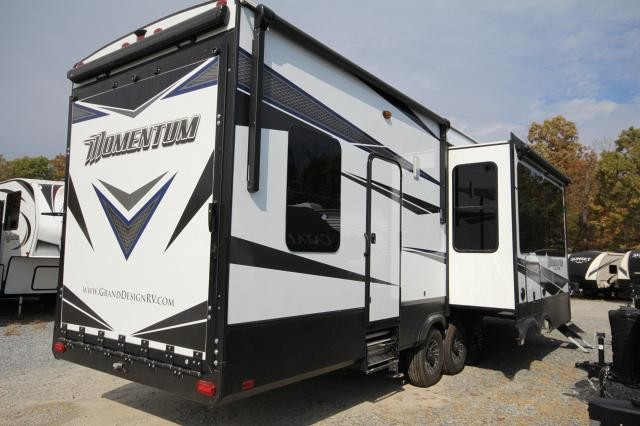 2018 Grand Design Momentum M-Class Toy Hauler 395M 2 Entry 1 1/2 Bath 3 Slides Theatre Seating Free Standing Dinette Entertainment Center w/ Fireplace CON