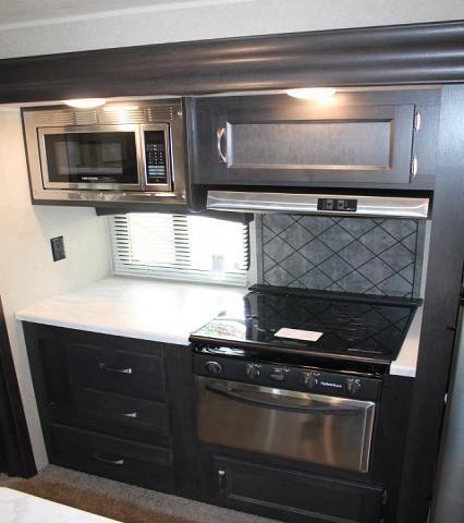 2018 palomino puma 31rkss travel trailer rear kitchen 2 - Rv kitchen appliances ...