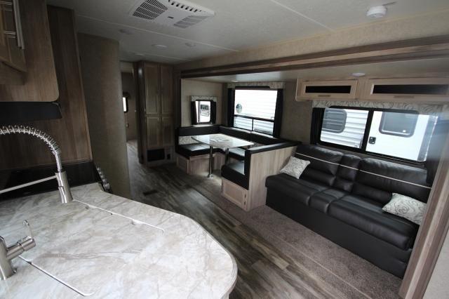 2019 Catalina Legacy Edition 323BHDSCK Rear Bunk House U-Shaped Dinette Jack Knife Sofa New Interior Modern Color Scheme Full Shower 2 Entries Solid Steps One Slide Large Outdoor Kitchen CONCORD NC