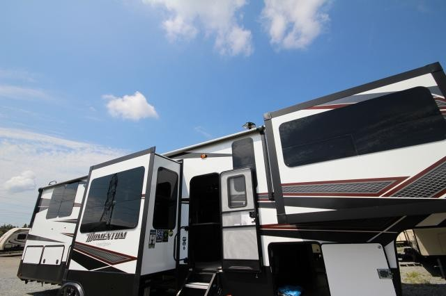 2019 Momentum Toy Hauler 376TH Front Living Tri-fold Sofas Theatre Seating Fireplace Free Standing Dinette Pantry Queen Bed Raises Over Garage Outside Ent. ONAN Generator CONCORD NC