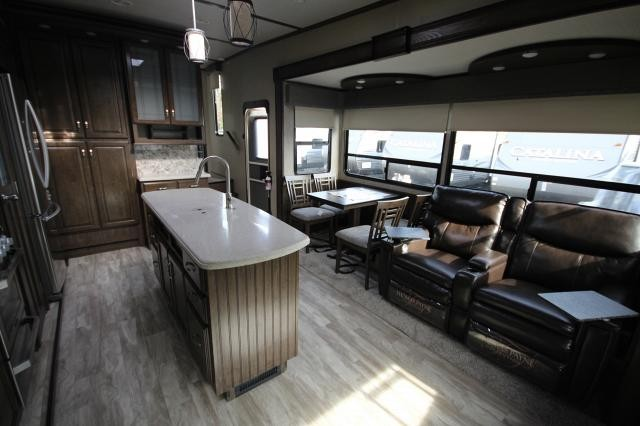 2019 Solitude Fifth Wheel ST3350RL-R Rear Living Fireplace Theatre Seating Free Standing Dinette Kitchen Island Residential Fridge Pantry Dbl Vanity Bathroom Full Shower Large Wardrobe Solid Step 3 Slides CONCORD NC